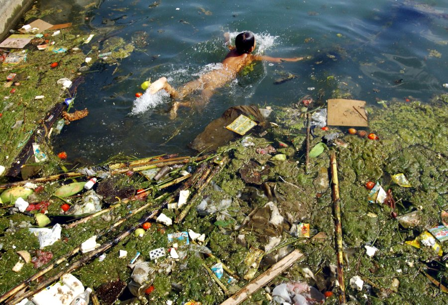 Child swims in a polluted reservoir southwest of chinas guizhou